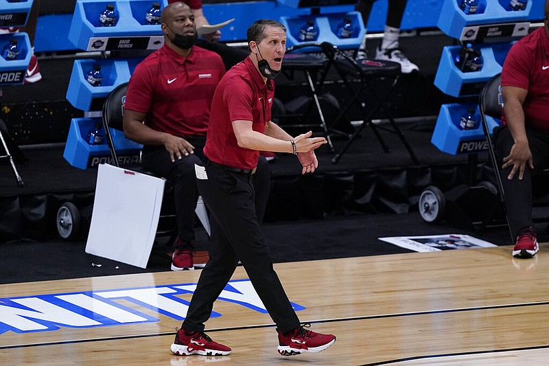 Arkansas head coach Eric Musselman watches against Baylor during the first half of an Elite 8 game in the NCAA men's college basketball tournament at Lucas Oil Stadium, Monday, March 29, 2021, in Indianapolis. (AP Photo/Michael Conroy)