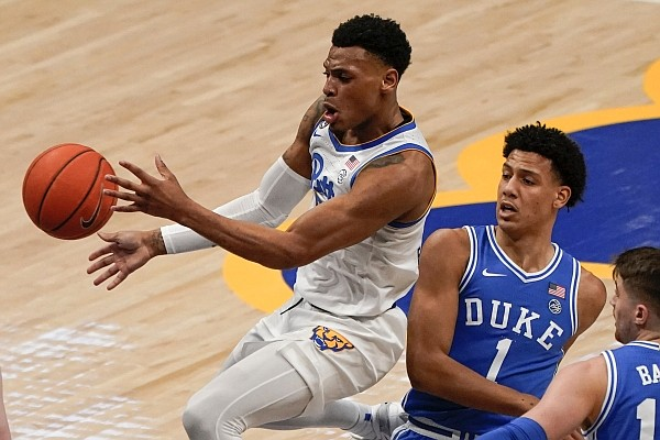 Pittsburgh's Au'diese Toney (5) passes after getting by Duke's Jalen Johnson (1) during the first half of an NCAA college basketball game, Tuesday, Jan. 19, 2021, in Pittsburgh. (AP Photo/Keith Srakocic)