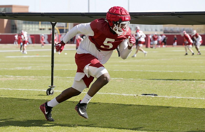 Dorian Gerald (5) participates in an agility drill during the University of Arkansas Razorback spring football practice Thursday, April 1, 2021, at the  practice field on the campus in Fayetteville. (NWA Democrat-Gazette/David Gottschalk)