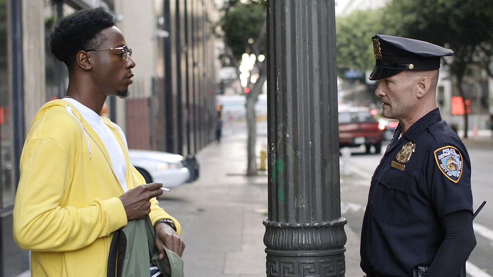 """The Oscar-nominated short film """"Two Distant Strangers"""" tells the story of cartoonist Carter (Joey Badas$$) trying to get home to his dog while being repeatedly thwarted by a racist cop (Andrew Howard)."""