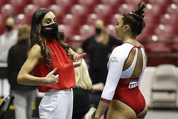 Arkansas gymnastics coach Jordyn Wieber (left) is shown during an NCAA regional on Friday, April 2, 2021, in Tuscaloosa, Ala. (Photo courtesy Crimson Tide Photos, via SEC Pool)