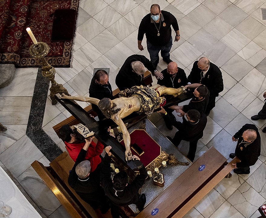 Parishioners carry the statue of a Christ of Esperanza after a Good Friday Mass at the Calatravas church in Madrid. Spain canceled Easter Week processions for the second year as Easter observances around the world have been curtailed during the coronavirus pandemic. More photos at arkansasonline.com/43goodfriday/. (AP/Manu Fernandez)