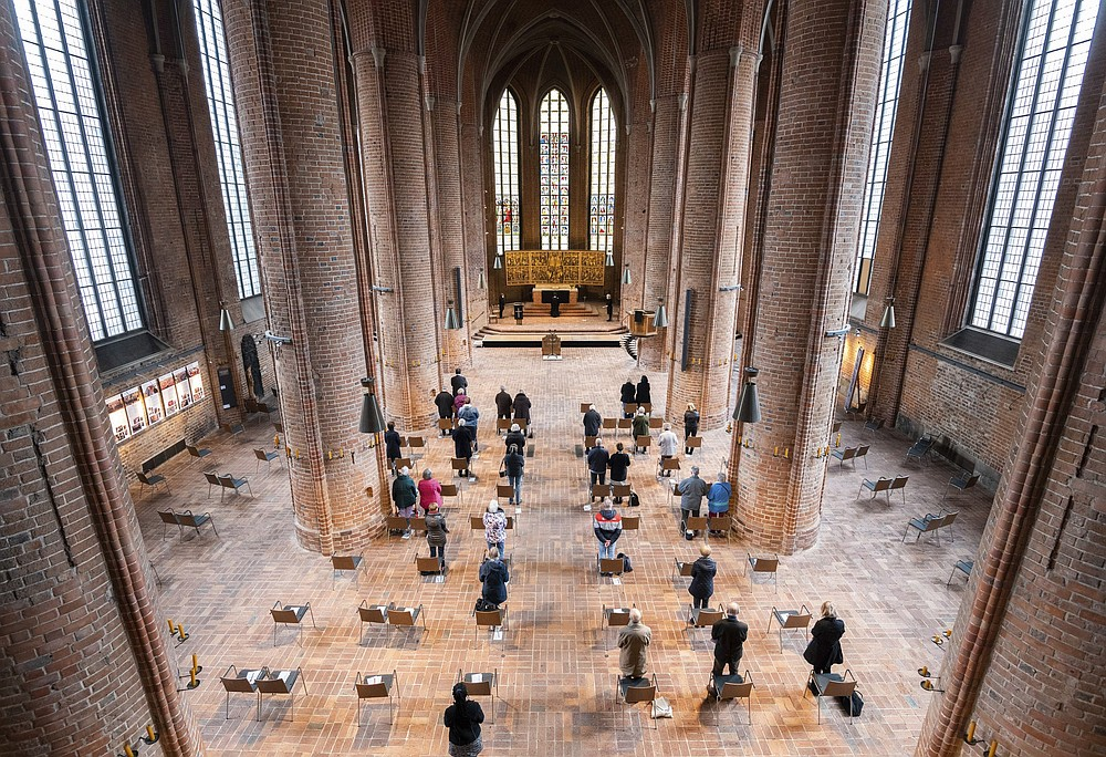 Worshippers attend a socially distanced Good Friday service at the Marktkirche in Hanover, Germany. (AP/dpa/Julian Stratenschulte)