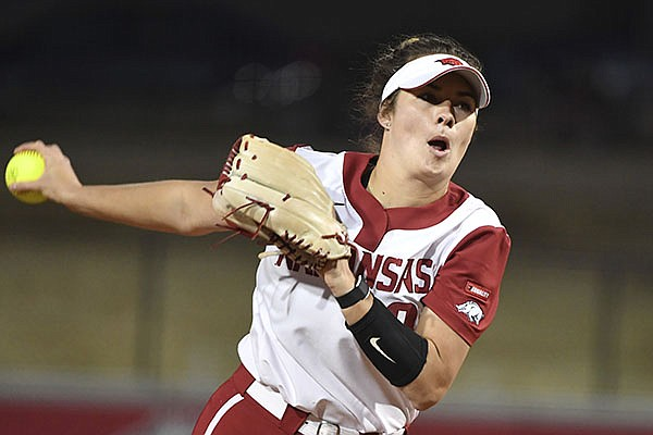 Arkansas pitcher Autumn Storms (9) throws against Mississippi State during an NCAA softball game on Friday, March 26, 2021, in Fayetteville. (AP Photo/Michael Woods)