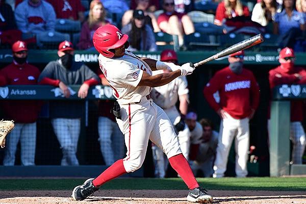 Arkansas center fielder Christian Franklin bats during a game against Auburn on Saturday, April 3, 2021, in Fayetteville.