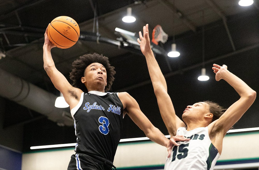 Sylvan Hills junior Nick Smith (shown) and Fort Smith Northside senior Jersey Wolfenbarger topped the lists of talented players on the Arkansas Democrat-Gazette's All-Arkansas Preps boys and girls basketball teams. They also were named the players of the year in the state. (Ark. Democrat-Gazette/Justin Cunningham)