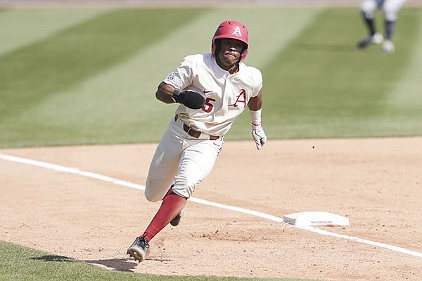Arkansas' Christian Franklin rounds third base during a game against Auburn on Saturday, April 3, 2021, in Fayetteville.