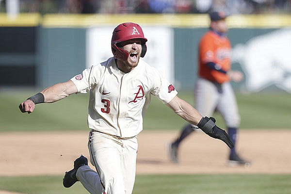 Arkansas left fielder Zack Gregory runs toward home to plate to score the winning run during a game against Auburn on Saturday, April 3, 2021, in Fayetteville.