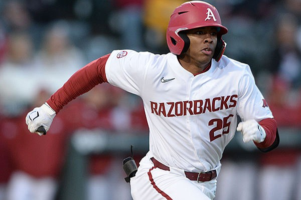 Arkansas center fielder Christian Franklin heads to first Thursday, April 1, 2021, after hitting during the fourth inning of play against Auburn at Baum-Walker Stadium in Fayetteville.