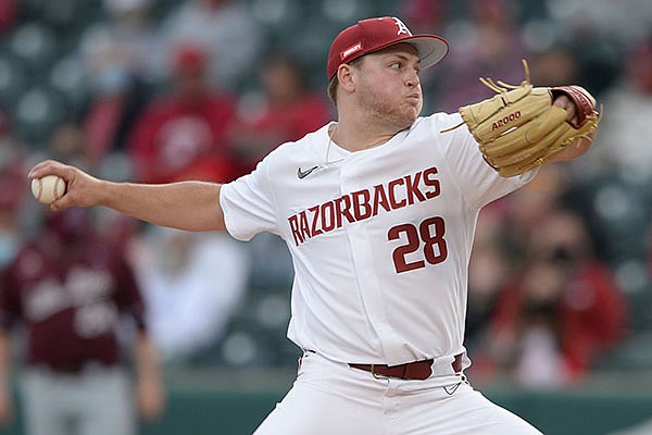 Arkansas starter Kole Ramage delivers to the plate Tuesday, April 6, 2021, during the second inning of play against UALR at Baum-Walker Stadium in Fayetteville.