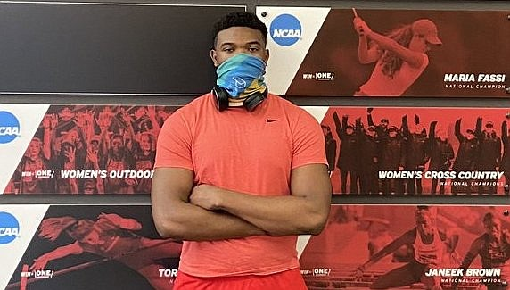 2022 DE Curlee Thomas IV stands in the Jerry and Gene Jones Academic Center.