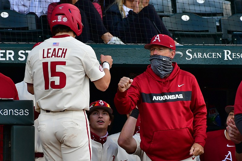 Dave Van Horn congratulates Dylan Leach during Arkansas' 10-3 win over Arkansas-Little Rock on Wednesday, April 7, 2021 at Baum-Walker stadium in Fayetteville. Picture courtesy SEC Media Pool.