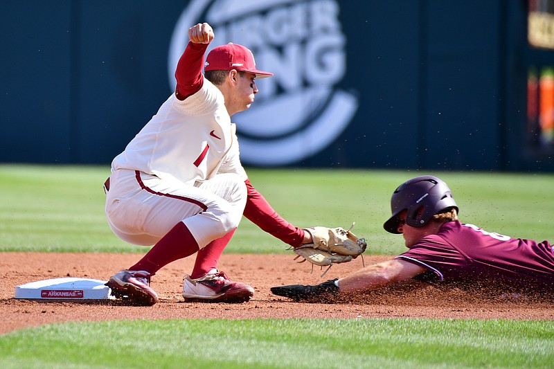 Arkansas second baseman Robert Moore tags out a would be base stealer during Arkansas' game against Arkansas-Little Rock on Wednesday, April 7, 2021. Picture courtesy SEC Media Pool.