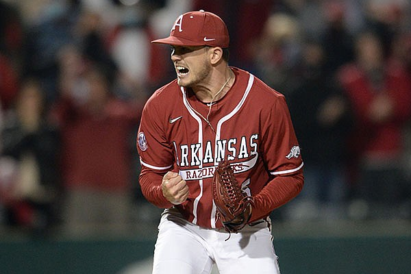 Arkansas reliever Kevin Kopps reacts Friday, April 2, 2021, after recording the final out of the Razorbacks' 6-5 win over Auburn at Baum-Walker Stadium in Fayetteville.