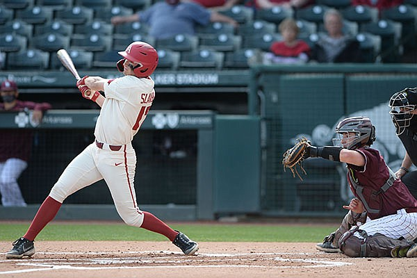 Arkansas first baseman Brady Slavens connects Wednesday, April 7, 2021, for a three-run home run during the first inning of the Razorbacks' 10-3 win over UALR at Baum-Walker Stadium in Fayetteville.