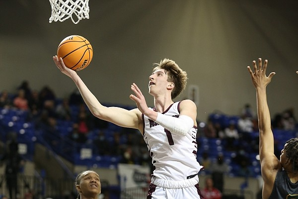 Morrilton's Joseph Pinion (1) lays in a shot over Mills' Jakari Livingston (5) during the fourth quarter of Mills' 49-46 win in the Class 4A boys state championship game on Saturday, March 10, 2021, at Bank OZK Arena in Hot Springs. More photos at www.arkansasonline.com/321boys4a/.