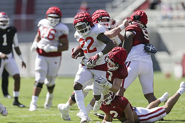 Arkansas running back Trelon Smith (22) carries the ball during a scrimmage Saturday, March 20, 2021, in Fayetteville.