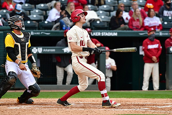 Arkansas' Matt Goodheart hits a home run during a game against Arkansas-Pine Bluff on Wednesday, April 14, 2021, in Fayetteville.