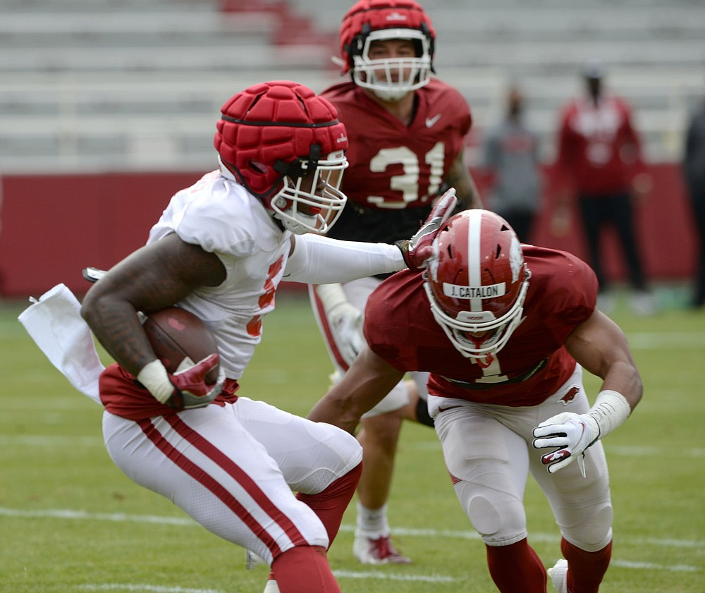 KJ Jefferson will lead the first-team offense on the white team against safety Jalen Catalon (shown) and the first-string defense on the red team during today's Red-White Game at Reynolds Razorback Stadium in Fayetteville. (NWA Democrat-Gazette/Andy Shupe)