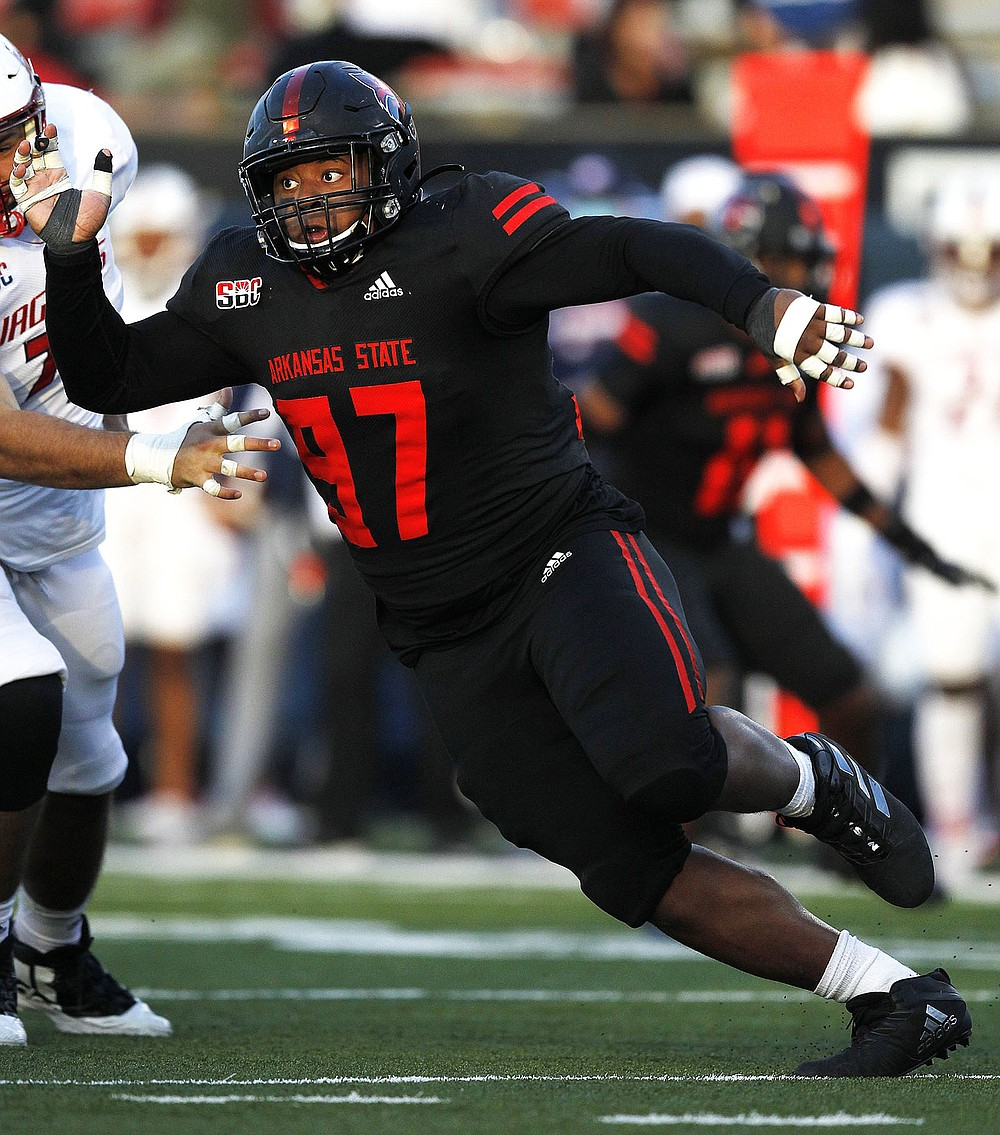 """Arkansas State University senior Terry Hampton said the Red Wolves' new defensive alignment gives more opportunities for everyone on the defensive line. """"We're going to be really dynamic. I can't give away too much, but we're going to get after it,"""" he said. (Arkansas Democrat-Gazette/Thomas Metthe)"""