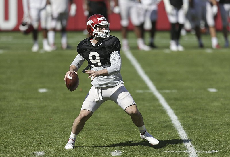 John Stephen Jones, shown during a scrimmage in Fayetteville last month, stood out in a quarterback target practice game during spring workouts this week. (NWA Democrat-Gazette/Charlie Kaijo)