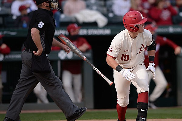 Arkansas designated hitter Charlie Welch watches Wednesday, April 14, 2021, as a two-run home run leaves the field during the third inning of the Razorbacks' 26-1 win over UAPB at Baum-Walker Stadium in Fayetteville.