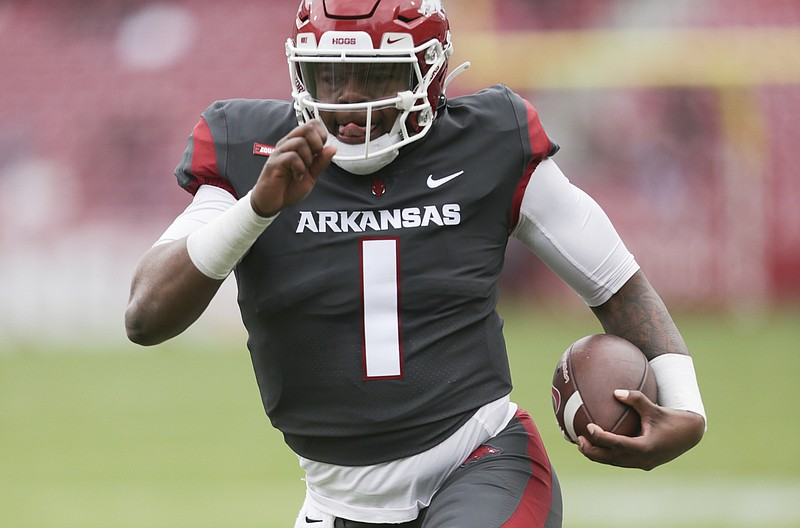 Arkansas quarterback KJ Jefferson (1) carries the ball, Saturday, April 17, 2021 during the first quarter of the Red-White spring football game at Razorback Stadium in Fayetteville. Check out nwaonline.com/210418Daily/ for today's photo gallery. .(NWA Democrat-Gazette/Charlie Kaijo)