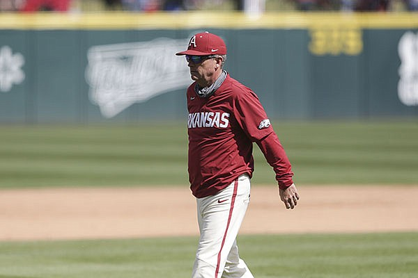 Arkansas coach Dave Van Horn walks toward the dugout during a game against Texas A&M on Sunday, April 18, 2021, in Fayetteville.
