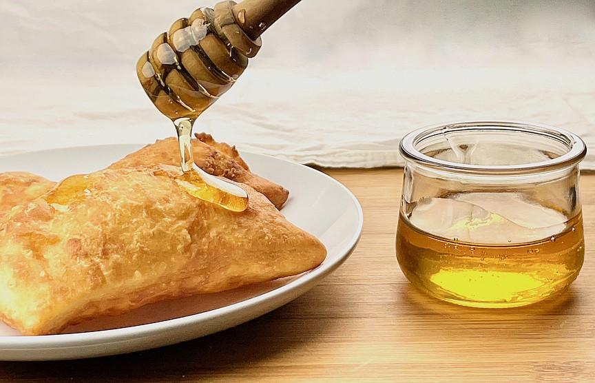 Sopaipillas with honey (Arkansas Democrat-Gazette/Kelly Brant)
