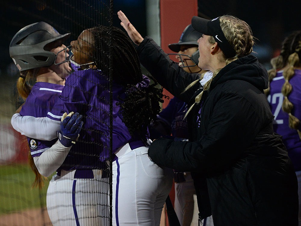UCA players celebrate after Tylar Vernon's two-run double tied the score 6-6 in the seventh inning against Arkansas on Wednesday night at Bogle Park in Fayetteville. The Razorbacks won 7-6 on a home run by Braxton Burnside in the bottom of the eighth. More photos at arkansasonline.com/422softball/