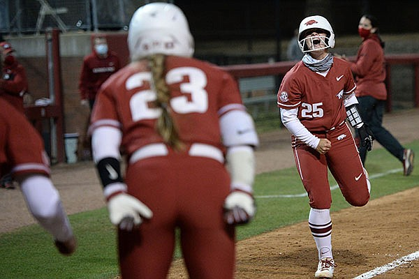 Arkansas shortstop Braxton Burnside (25) celebrates Wednesday, April 21, 2021, after hitting a game-winning solo home run during the eighth inning of the Razorbacks' 7-6 walk-off win over Central Arkansas at Bogle Park in Fayetteville.