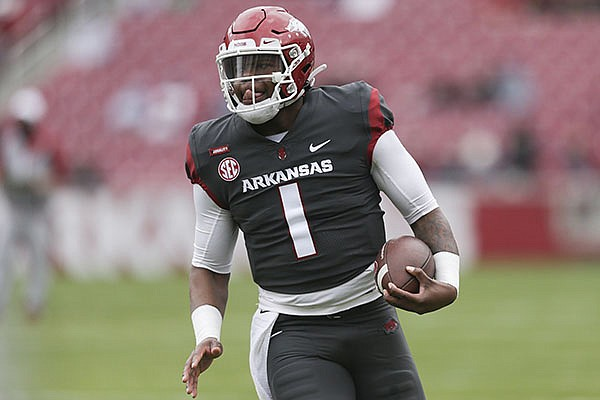 Arkansas quarterback KJ Jefferson carries the ball during the Razorbacks' Red-White spring football game Saturday, April 17, 2021, in Fayetteville.