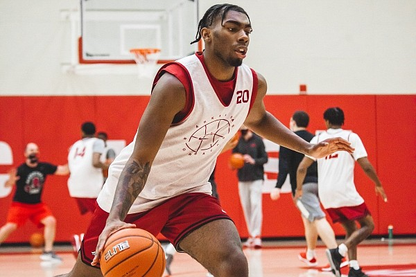 Arkansas forward Kamani Johnson dribbles during a practice on Dec. 19, 2020, at the Basketball Performance Center.