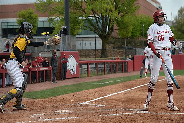 Arkansas right fielder Aly Manzo (66) and Missouri catcher Hatti Moore (left) react Saturday, April 24, 2021, after Manzo struck out with two on base to end the sixth inning of the Razorbacks' 6-4 loss at Bogle Park in Fayetteville.
