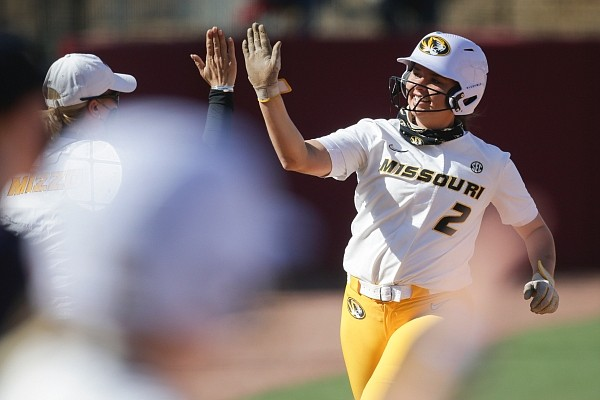 Missouri infielder Kendyll Bailey (2) scores, Sunday, April 25, 2021 during a softball game at Bogle Park in Fayetteville. Check out nwaonline.com/210426Daily/ for the photo gallery.