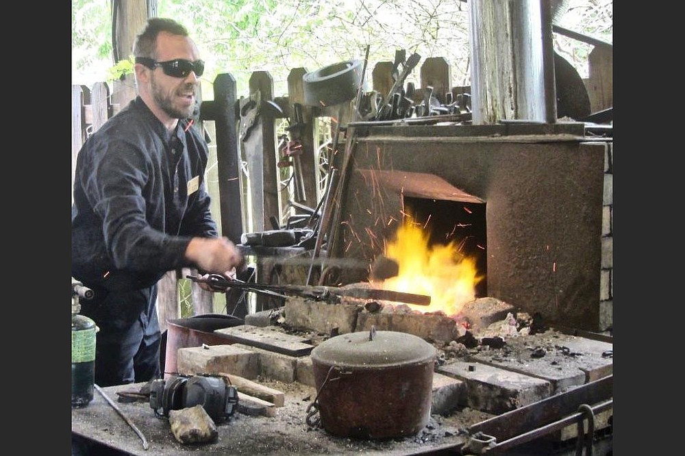 Blacksmith Sam Hibbs works with heated metal at Ozark Folk Center. (Special to the Democrat-Gazette/Marcia Schnedler)