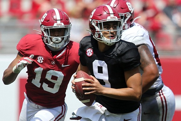 White team quarterback Bryce Young (9) rolls away from pressure during Alabama's spring NCAA college football game at Bryant-Denny Stadium, Saturday, April 17, 2021, in Tuscaloosa, Ala. (Gary Cosby/The Tuscaloosa News via AP)