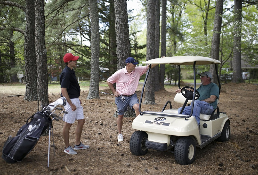 Taylor Bryant (from left) and Marc Bryant chat with co-owner Bobby Rountree, Monday, April 26, 2021 at the Prairie Creek golf course in Rogers. The Prairie Creek golf course is closing after 50 years of ownership in the Rountree family. Check out nwaonline.com/210427Daily/ for today's photo gallery. .(NWA Democrat-Gazette/Charlie Kaijo)