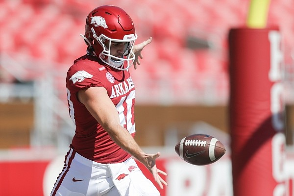 Arkansas punter George Caratan (40) practices, Saturday, September 26, 2020 before a football game at Donald W. Reynolds Razorback Stadium in Fayetteville. Check out nwaonline.com/200927Daily/ for the photo gallery.