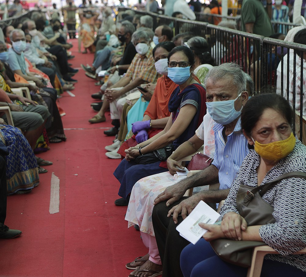 People wait to get covid-19 vaccinations Thursday in Mumbai as India reported another global record in new virus cases. The U.S. government is flying more than $100 million in coronavirus aid to India to help overstretched hospitals and front-line health care workers. (AP/Rajanish Kakade)