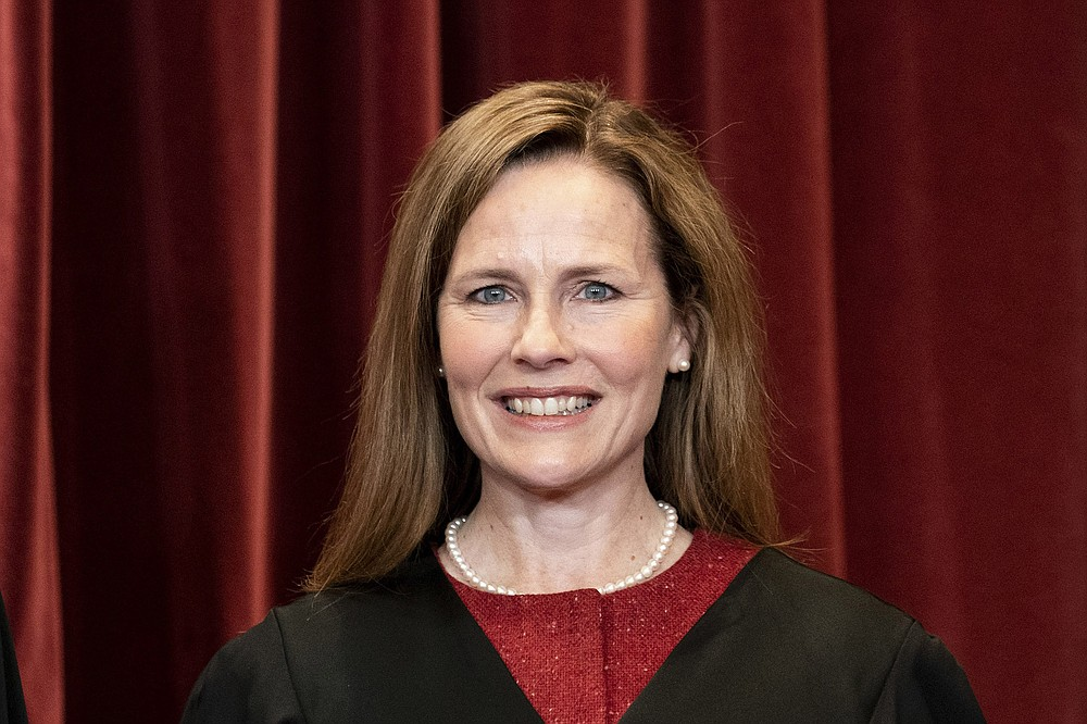 Associate Justice Amy Coney Barrett stands for a group photo of the justices, at the Supreme Court building in Washington, April 23, 2021. (Erin Schaff/The New York Times)