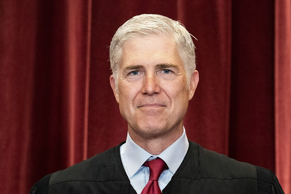 Associate Justice Neil Gorsuch stands for a group photo of the justices, at the Supreme Court building in Washington, April 23, 2021. (Erin Schaff/The New York Times)