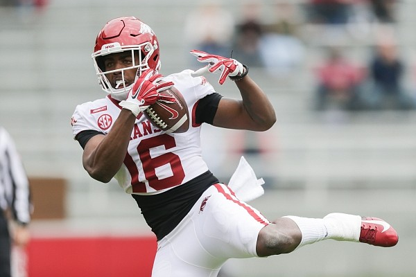 Arkansas wide receiver Treylon Burks (16) scores a touchdown, Saturday, April 17, 2021 during the first quarter of the Red-White spring football game at Razorback Stadium in Fayetteville. Check out nwaonline.com/210418Daily/ for the photo gallery.