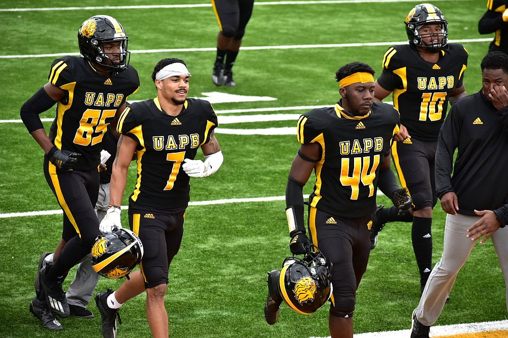Receivers Christopher Robinson (from left), Tyrin Ralph, linebacker Monroe Beard III and backup quarterback Torrence Bardell of UAPB have one last game to play this spring, and it's for the SWAC championship. (Pine Bluff Commercial/I.C. Murrell)