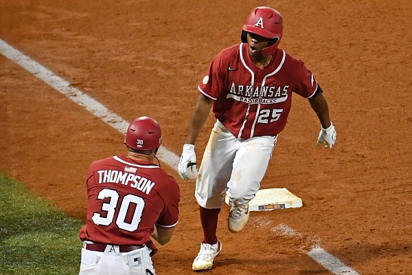 Arkansas center fielder Christian Franklin celebrates with hitting coach Nate Thompson after hitting a home run during a game against LSU on April 30, 2021, in Baton Rouge, La.