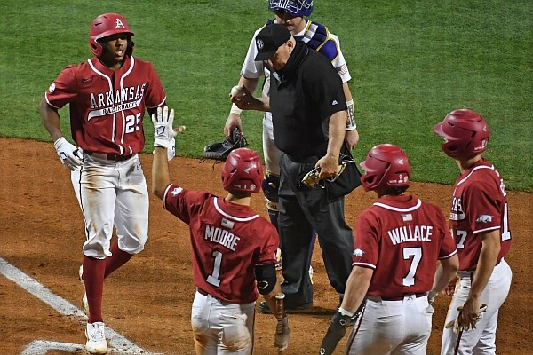 Arkansas center fielder Christian Franklin runs toward teammates after hitting a home run during a game against LSU on April 30, 2021, in Baton Rouge, La.