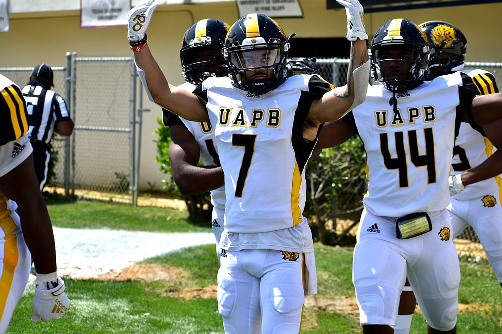 UAPB return specialist Tyrin Ralph celebrates his 81-yard kickoff return for a touchdown in the first half Saturday against Alabama A&M in the Southwestern Athletic Conference Championship Game. The Golden Lions led 26-18 at halftime, but lost 40-33 in their first conference title game since 2012. (Pine Bluff Commercial/I.C. Murrell)
