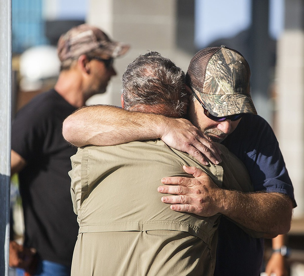 "Scott Daspit, father of missing crew member Dylan Daspit, gets a long hug of support Thursday at Harbor Light Marina in Cocodrie, La. ""If we can find one soul it'll be worth it,"" Daspit said.