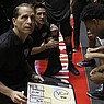 Nevada head coach Eric Musselman (foreground) and assistant coach Gus Argenal give instructions to players before the start of an NCAA college basketball game against New Mexico in Albuquerque, N.M., Saturday, Jan. 5, 2019. (AP Photo/Andres Leighton)