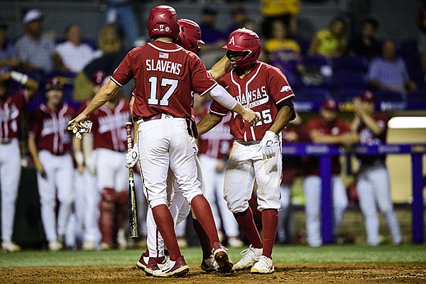 Arkansas' Christian Franklin (25) is congratulated after he hit a home run during a game against LSU on Friday, April 30, 2021, in Baton Rouge, La. (Photo by Brandon Gallego/LSU Athletics)
